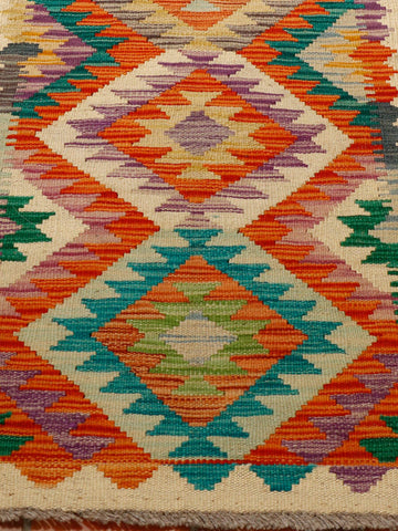 vivid colours used in this kilim runner of orange, purple, teal and cream.