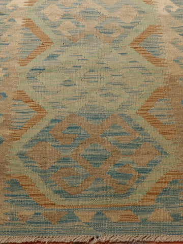 unusually soft shades in this kilim runner which is essentially blue, grey, spearmint and pale terracotta.