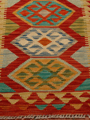 Strong colours of terracotta, turquoise, green and gold have been used in this kilim.