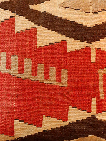 Turkish kilim cushion with soft orange red as the main colour with brown, gold and cream.