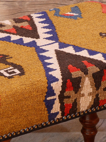 Predominently gold colouring with brown, terracotta, blue and cream.