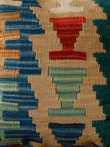 A mix of gold, blue, terracotta and green used in this kilim cushion
