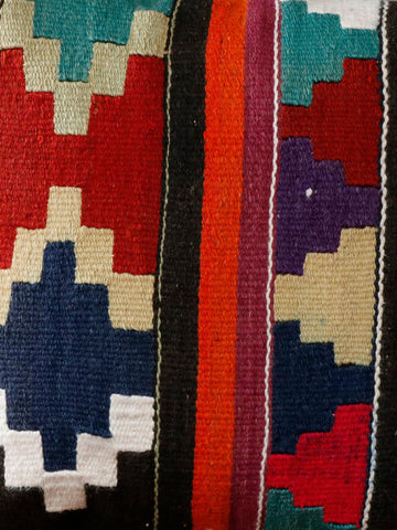 Multi colours of orange, purple, teal, black, gold and red in this kilim cushion.