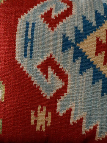 Light blue, mid blue, terracotta, gold and cream colourings in this kilim cushion.