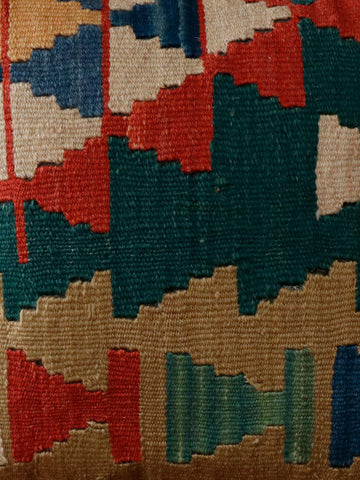 Geometric Turkish kilim cushion is colours of terracotta, gold, cream blue and a deep sea green.