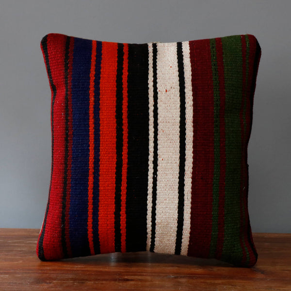 Turkish kilim cushion with black, orange, cream, blue and burgundy stripes