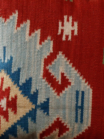 A mix of terracotta, light blue, dark blue and gold used for this kilim cushion
