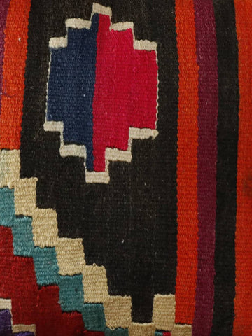 Modern colours of cerise, orange, black, teal and burgundy used in this kilim cushion.