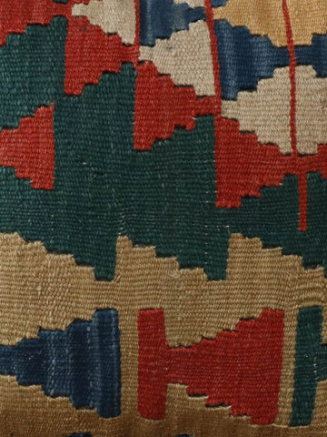 Bottle green, terracotta, blue, cream and gold are in this Turkish kilim cushion