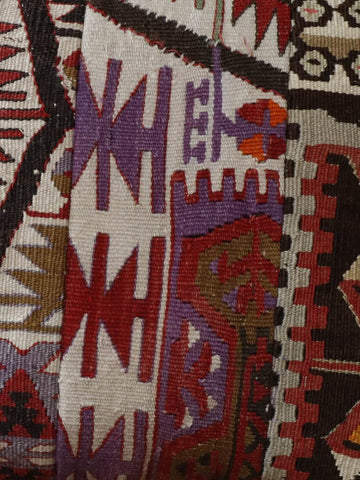 Made in 3 panels this kilim cushion has colours of red, cream, black, purple and green 40 x 40cm 1'4 x 1'4