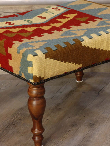 Multicoloured kilim covered stool which can double up as coffee table 60 x 45 x 38cm - (2'0 x 1'6 x 1'3)