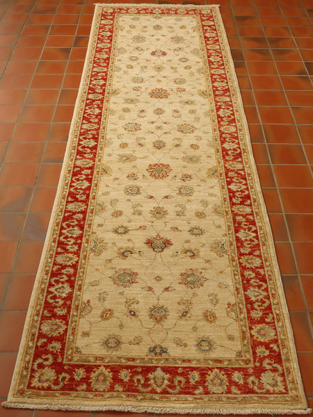 This 9ft runner at first glance may look like a typical Ziegler piece in a classic combination of red cream and gold with hints of blue. However, the piece is very much finer than many Ziegler carpets the wool is certainly more lustrous and it has unique fine detailing completed in art silk. I think most people would agree that this is a premier hand-knotted runner.