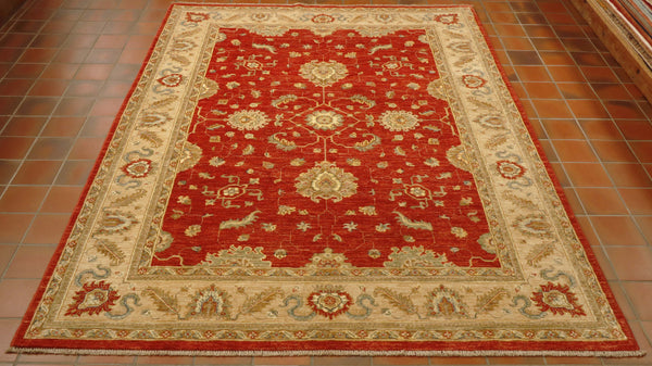 This Afghan Ziegler has a stunning, intricate floral design both in the main section and in the borders.  The main ground is terracotta red.   With the borders being golden soft yellow, ochre, soft green and terracotta highlights.  Silk work outlines some of the areas adding to the piece's beauty.