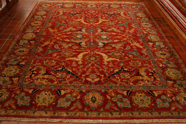 A superb example of an old Persian Serapi design which has been hand made in northern India. The colourings are rich autumnal shades of a rusty terracotta, old gold, navy blue, caramel, teal, soft blue and pale green. The thick pile is made from Indain wool woven on to a cotton warp and weft.