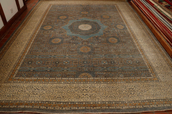 A stunning ancient design has its origins in Egypt. The complex pattern is repeating circles around a central panel, The carpet is very high grade constructed in wool on a cotton foundation. The rug  colours are shades of blue  gold and ivory.