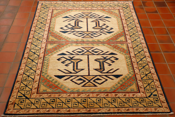 Although this rug has been made in north west Afghanistan the design originates from Turkey as it is an old Anatolian pattern. It is very finely knotted using a wool pile on to a cotton foundation. The colours used are predominantly cream with soft gold, some pale green and soft salmon with the geometric design in dark blue.