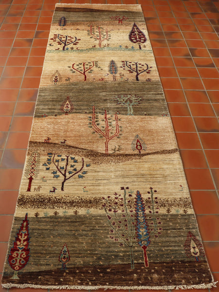 A lovely natural coloured wool runner showing a countryside scene with hills and dales. lots of stylised trees and little goats.
