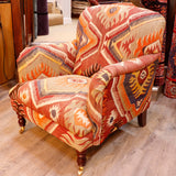 These designs meet in the middle on the back of the chair and form the central section on the seat.  The colour palette is rich in red, orange, green and yellows, with a soft blue and deep brown adding high lights.