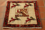 This its an unusual pictoral Qashqai square.  It has a cream background with a large square in the middle with a handsome peacock taking centre stage. In the four corners are two pairs of leaping deers. The border is a brick red with flowers and birds all round the edge. This piece is made of wool woven on to cotton with a fairly thick pile.