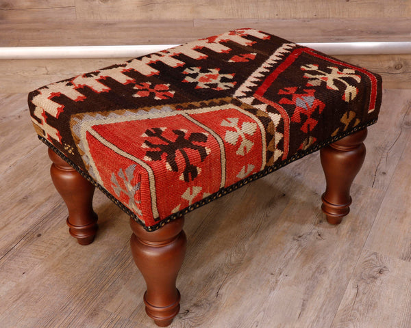 Theses Turkish Kilim stools often uses salvaged pieces.  This use produces an interesting look with the pattern being offset rather than centred, making the pieces unique and different.  This has an Autumnal mix of colours, very earthy tones consisting of dark brown, soft red tan and cream with the odd touch of soft blue. The design is geometric shapes, almost snowflake like.