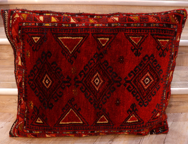 Bolesht bag is a name given to a long narrow bag usually with carpet pile on one side and a plain flatweave (kelim) on the reverse side.  This bag is a deep, sumptuous red colour with three diamond depictions on it in dark blue, dark red and yellow.  The border is decorated in triangles in the same colour palette.  The reverse being in a striped brown and red kelim.