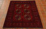 Six medallions laid out in a symmetrical pattern across the main part of this rug using deep blue and an oatmeal shade can be seen.  There are a number of borders of varying widths with geometric designs upon them, again using the deep blue on a strong red ground.  Shots of orange/yellow are used to highlight aspects of the design.