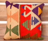 The pieces are often salvaged from old Turkish or Anatolian kilim so the pattern may be cut in unusual and interesting ways.   The colour palette on this rug is one of cream and bright red predominantly.  With motifs being in shades of purple, tan, green, yellow and peachy mushroom.  The back of the cushion is usually Faux suede or cotton.