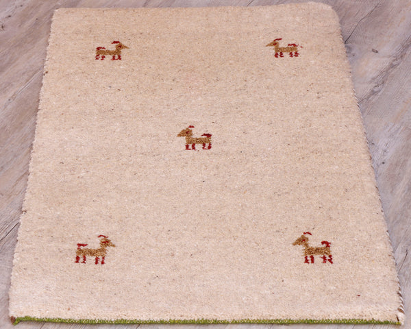 This small mat is a plain cream ground with 5 small goats in brown, with red legs, tails and antlers.  One in the centre and one in each corner.