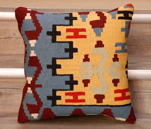 The pieces are often salvaged from old Turkish kilim so the pattern may be cut in unusual and interesting ways.  The decoration is made up of geometric shapes. The brightly coloured Kilim has touches of vibrant reds, soft blues, yellows, blacks and burgundy which contrast against the other colours on the facing side, whereas the back of the cushion is Faux suede or cotton.