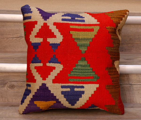 The pieces are often salvaged from old Turkish kilim so the pattern may be cut in unusual and interesting ways.  The decoration is made up of geometric shapes. The brightly coloured Kilim has touches of vibrant reds, blues, purples and greens which contrast against the other colours on the facing side, whereas the back of the cushion is Faux suede or cotton.