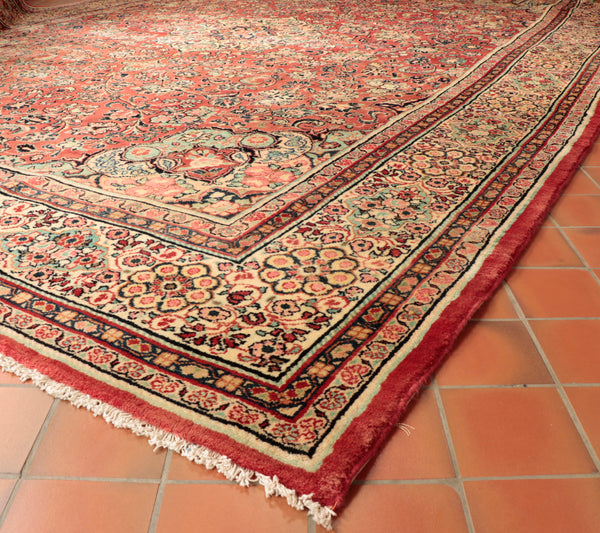 A large hand knotted Persian Mahal carpet in softer muted colourings.
