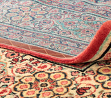 An elegant Persian Mahal carpet with touches of pink and green colouring.