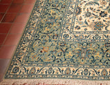 The floral detail on this Kashan carpet is highlighted in old old and burgundy red.