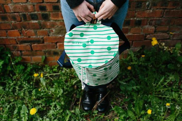 Green rucksack designed by Laura Spring