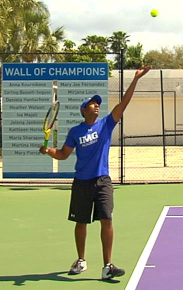 Figure 5.7 Tossing action for a serve.