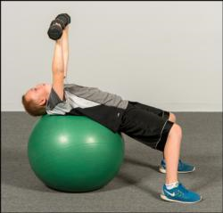 Figure 12.2 A press exercise on a stability ball may be dangerous for an inexperienced athlete.