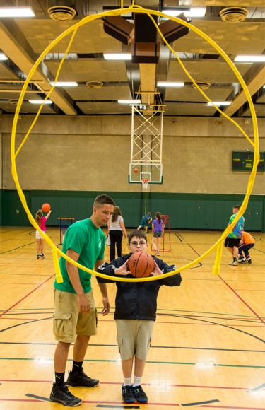 Students with disabilities should be included in a GPE class and assessed on their individual skill levels.