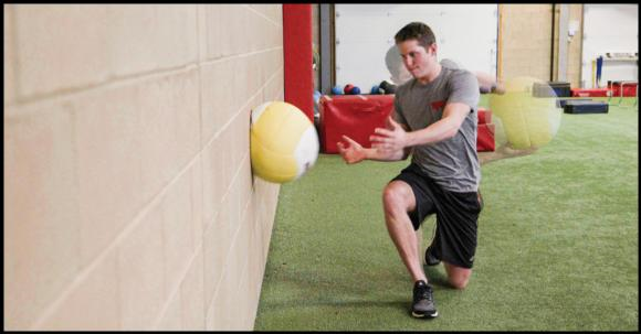 Figure 7.28 Medicine ball half-kneeling side-twist throw.