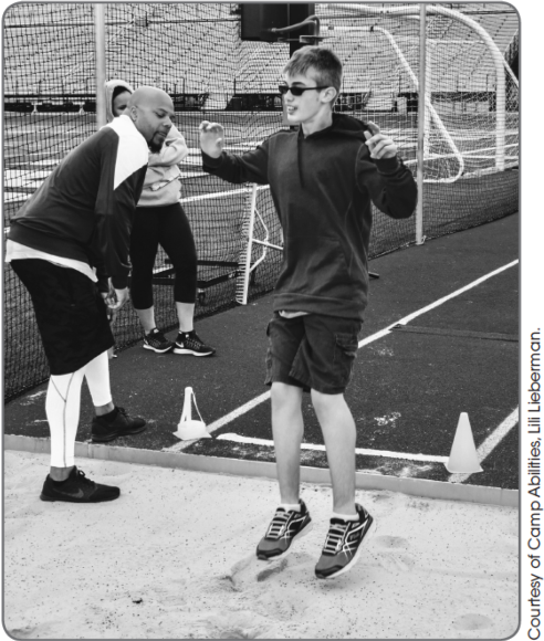 Figure 10.20A student performs a standing long jump.