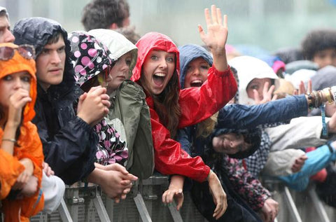 girl in rain coat at festival