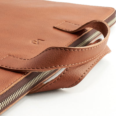 Handles detail. Tan leather laptop portfolio. Business document organizer for men.