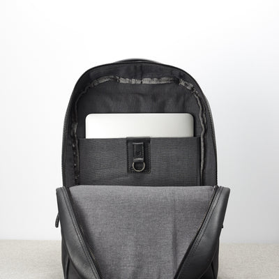 Linen interior, Macbook pro 15 inc compartment. Black leather backpack for men