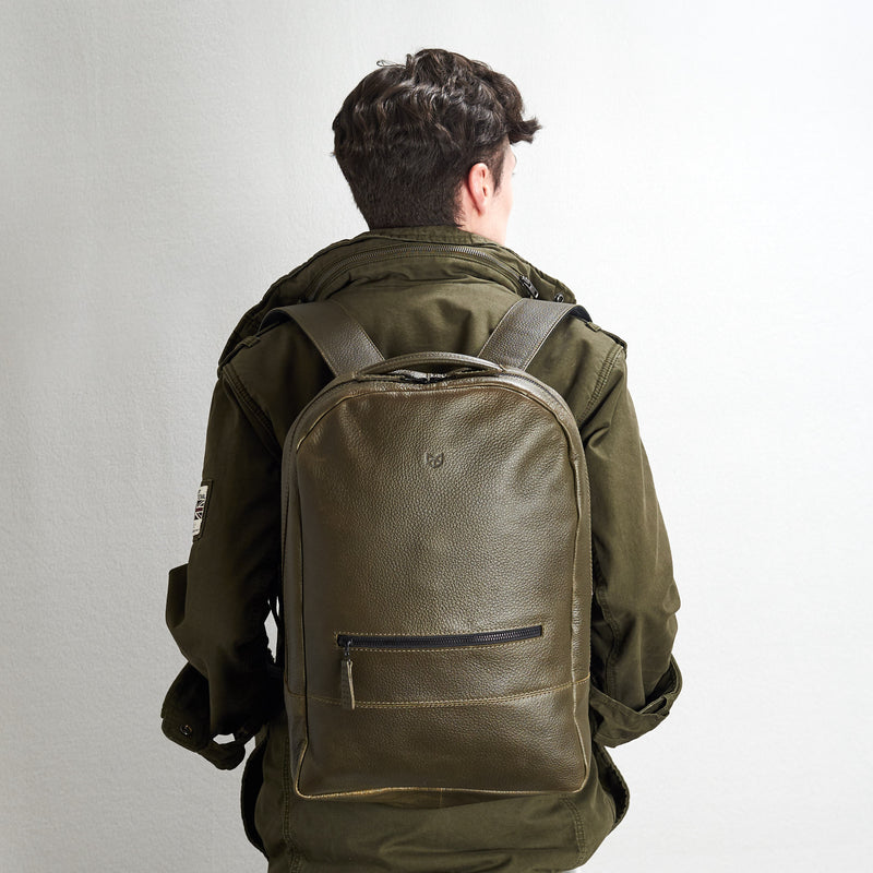 Minimalist green leather backpack for men. Handmade full grain leather rucksack