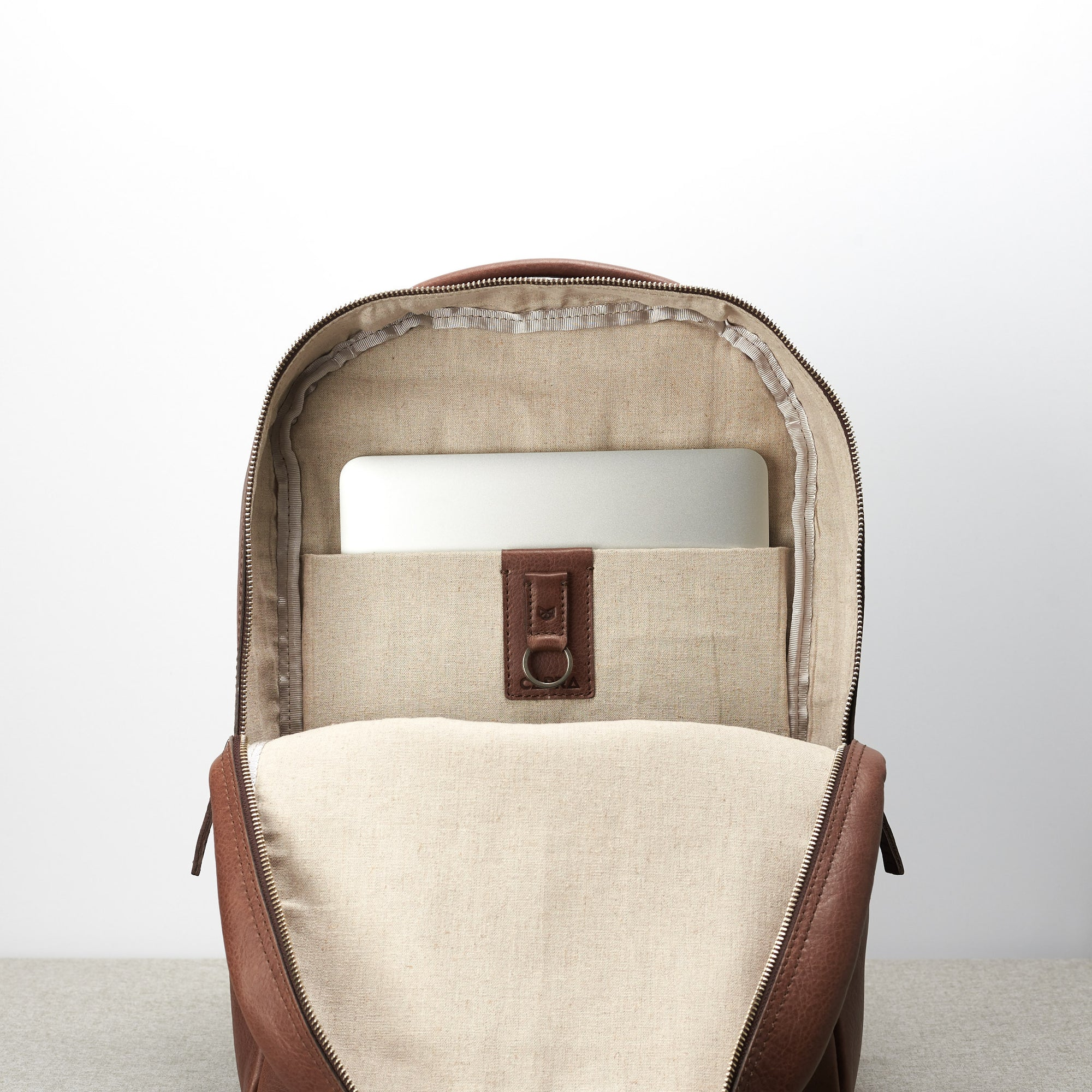 Minimalist brown leather backpack for men. Handmade full grain leather rucksack