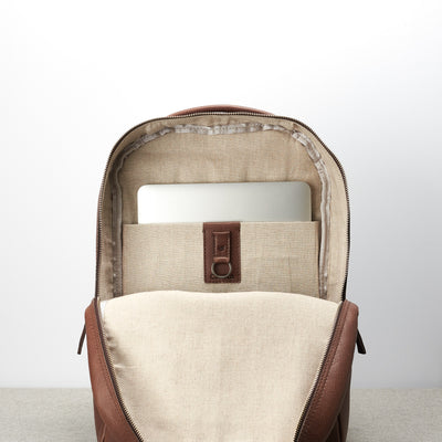Inside compartment for 15inc Macbook pro. Minimalist brown leather office backpack for men.
