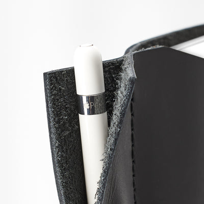 Apple pencil detail. Black iPad pro leather case with pen holder. Soft leather interior