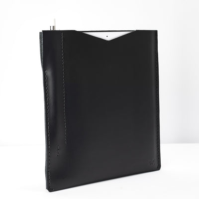 Side from the slim iPad pro sleeve. Black iPad pro leather sleeve with apple pencil holder