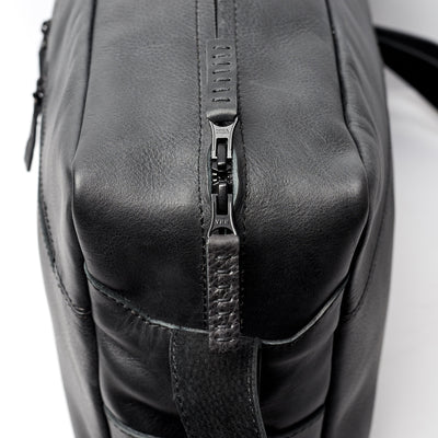 YKK metallic zippers. Back handmade leather messenger bag for men. Commuter bag, laptop leather bag by Capra Leather.