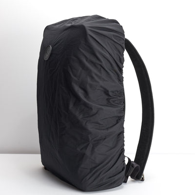 Black rain cover backpack accessory. Waterproof cape for Capra backpacks