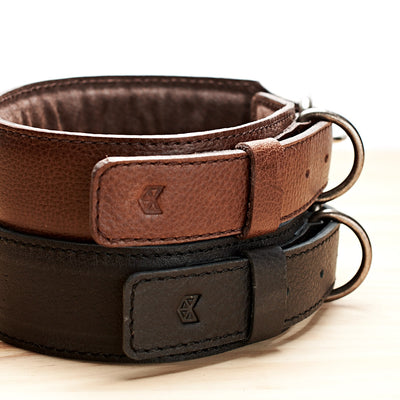 Handmade minimal black and dark brown leather padded dog collars by Capra Leather.